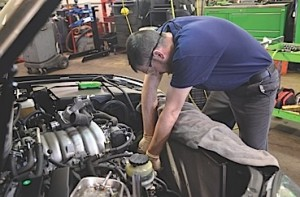 Lead technician Patrick Shepard starts a water pump replacement job.