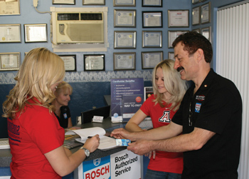 university of arizona students amanda berg (l) and devon gregory use the bosch service credit card.
