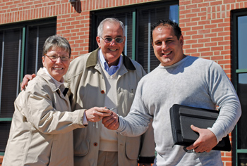 jim torres and his wife, vivian (left) pass the keys to new owner joe cunha (right).