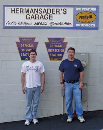 the buyers: new owners of hermansader's garage, chris yost (left) and his father-in-law jeff pettit, pose in front of their newly acquired business.